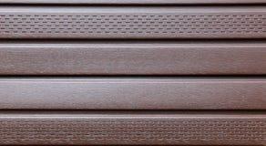 布朗塑料房屋板壁 图库摄影