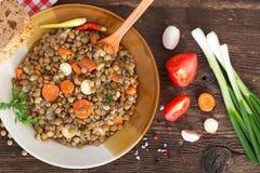 布朗扁豆炖煮的食物 免版税库存图片