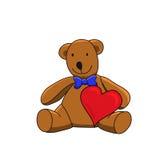 布朗拿着红色心脏的玩具熊 库存照片