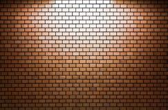 布朗有聚光灯的砖墙 库存图片