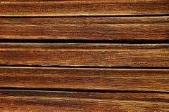 布朗木板条书桌桌背景纹理顶视图 库存图片