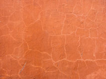 布朗桔子涂灰泥的墙壁表面 免版税库存图片