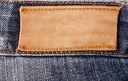 布朗牛仔裤标签 库存照片