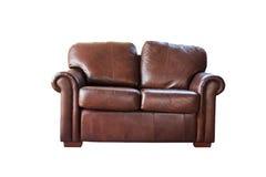 布朗用皮革包盖在白色背景隔绝的沙发 库存照片