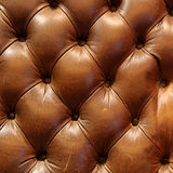 布朗皮革长沙发纹理 免版税库存图片
