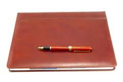 布朗盖子笔记本 免版税库存图片