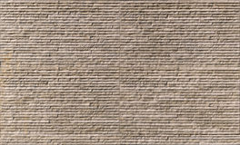 布朗石墙纹理 免版税库存图片