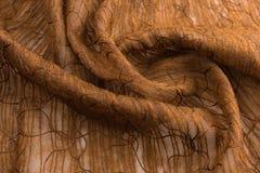 布朗背景豪华布料或难看的东西丝绸纹理缎天鹅绒波浪折叠  库存照片