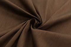 布朗背景豪华布料或难看的东西丝绸纹理缎天鹅绒波浪折叠  库存图片