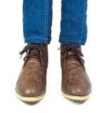 布朗鞋子和蓝色牛仔裤 库存图片