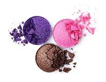 布朗,紫罗兰色和桃红色发光的眼影膏 免版税库存照片