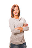 布朗头发美丽的妇女用穿灰色衬衣a的发怒手 库存图片