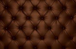 布朗capitone方格的教练皮革装饰 库存照片
