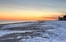 布赖顿和科尼岛海滩日落 免版税图库摄影
