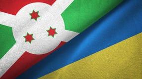 布隆迪和乌克兰两旗子纺织品布料,织品纹理 皇族释放例证