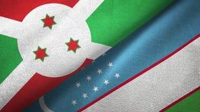 布隆迪和乌兹别克斯坦两旗子纺织品布料,织品纹理 皇族释放例证