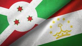 布隆迪和塔吉克斯坦两旗子纺织品布料,织品纹理 皇族释放例证