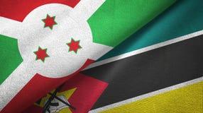 布隆迪和莫桑比克两旗子纺织品布料,织品纹理 库存例证