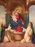 布雷西亚,意大利, 2016年:玛丹娜绘画有十字架和圣Avilla Theresia的carmelitans的圣约翰  免版税图库摄影