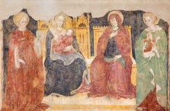 布雷西亚-壁画哺乳Bandona和教会基耶萨di圣弗朗切斯科d `的阿西西圣徒妇女 免版税图库摄影