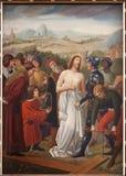 布鲁塞尔-耶稣被剥夺他的服装。从st.尼克斯的油漆和从19。分的吉恩s教会。 免版税库存图片