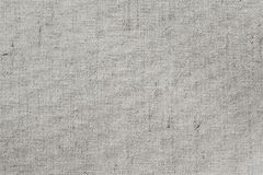 帆布、织品、背景与可看见的纹理拷贝空间文本的和其他网印刷品设计元素 .30-06步枪螺栓和范围特写镜头在camo背景 免版税库存照片