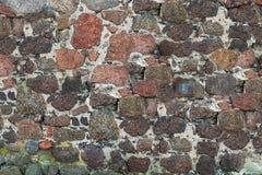 帆布粗砺的石头结合与水泥红褐色的灰色基地 免版税库存照片