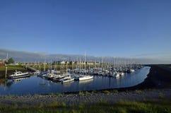 帆船在港口在日出的西兰荷兰 免版税库存照片