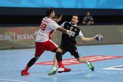 贝希克塔什MOGAZ HT和迪纳莫队布加勒斯特手球比赛 免版税库存照片
