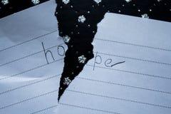 希望在一被撕毁的板料的词 免版税库存照片