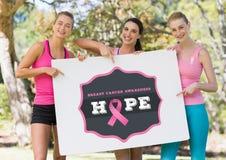希望拿着卡片的文本和桃红色乳腺癌了悟妇女 库存照片