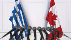 希腊和加拿大的旗子在国际会议或交涉新闻招待会 股票录像