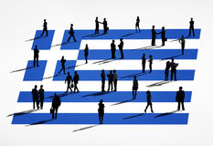 希腊旗子和一个小组商人 免版税库存照片