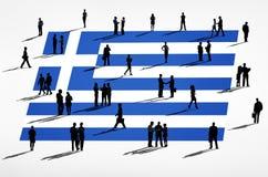 希腊旗子和一个小组商人 图库摄影