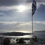 希腊旗子圣托里尼海岛太阳 库存照片