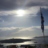 希腊旗子圣托里尼海岛太阳 免版税库存照片