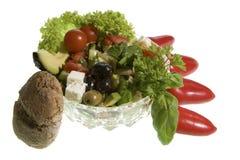 希腊沙拉用整粒面包 库存图片
