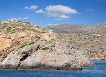 希腊海岛Ios灯塔在基克拉泽斯小组的 库存图片