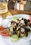 希腊烤海岛用卤汁泡的章鱼taverna 图库摄影