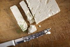 希腊白软干酪块 库存图片