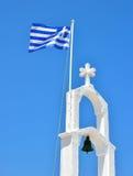 希腊的白色和蓝色国旗在教会里 免版税库存图片