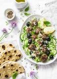 希腊羊羔丸子用鲕梨希腊酸奶调味,蒸丸子和整个五谷小面包干在轻的背景,顶视图 Mediterr 免版税图库摄影