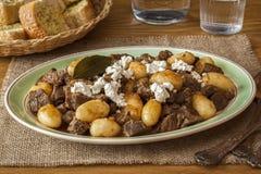 希腊羊羔炖煮的食物用希脂乳 免版税图库摄影