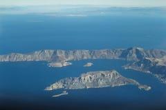 希腊语泰伦佐斯岛和一部分埃拉尔铝合金观点的从十二群岛群岛的卡林诺斯岛海岛 免版税库存照片