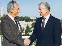希蒙・佩雷斯在耶路撒冷招呼吉米・卡特 免版税库存照片