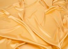 帏帐金黄丝绸 库存图片