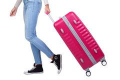 带着一个桃红色手提箱的女孩旅客 背景查出的白色 库存照片