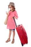 带着一个红色手提箱的小女孩谈话在电话 免版税图库摄影