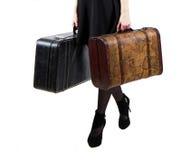 带着两个手提箱的女孩 免版税库存照片