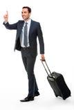 带着停止出租汽车的手提箱的商人 免版税库存图片